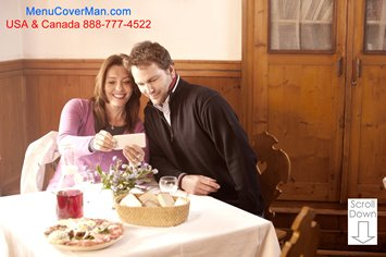 Happy couple at restaurant taking a selfie.  Menu jackets that are beautifully imprinted for your restaurant.