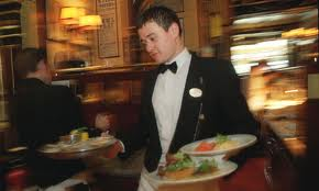 Talented waiter in a busy restaurant.